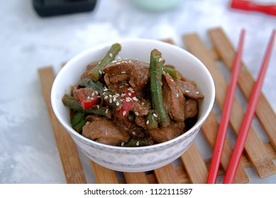 Fried chicken liver with green beans and sweet pepper in Asian style