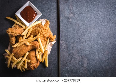 Fried chicken meat and French fries from above,blank space on the right side