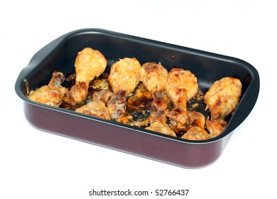 The fried chicken meat lying on a frying pan.
