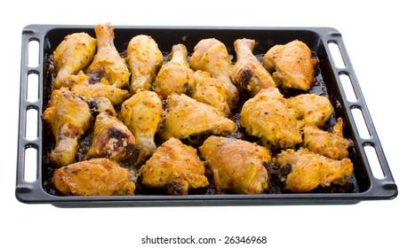 fried chicken meat on baking sheet