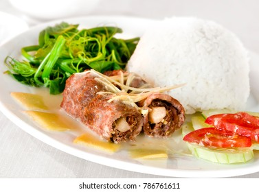 Fried chicken with mushrooms rolls and white rice