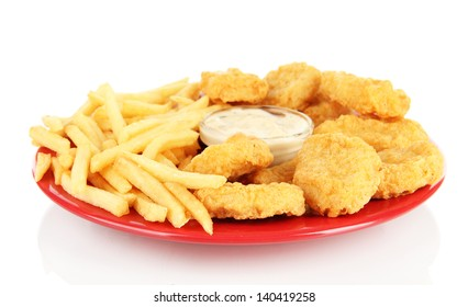 Fried chicken nuggets with french fries and sauce isolated on white