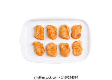 Fried chicken nuggets on white plate isolated on white background. Hot fastfood. Top view Food Image for menu card, web design, site, shop or delivery. High quality retouch and isolation.