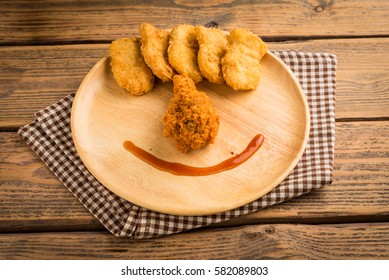 Fried chicken and nuggets on  wood table.