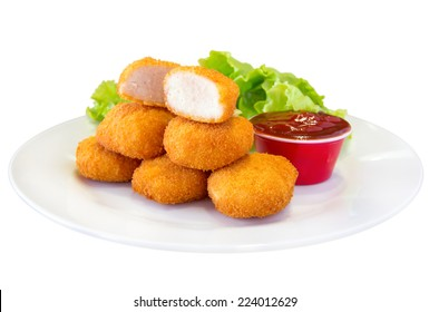 Fried chicken nuggets and sauce, isolated on white.