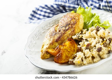 Fried chicken with oranges and couscous