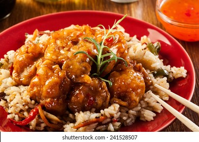 Fried chicken pieces with rice and sweet and sour sauce