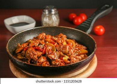 Fried chicken red meat with stewed vegetables in soy sauce in a frying pan.
