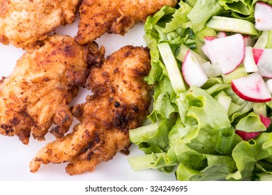 fried chicken with salad and potatoes