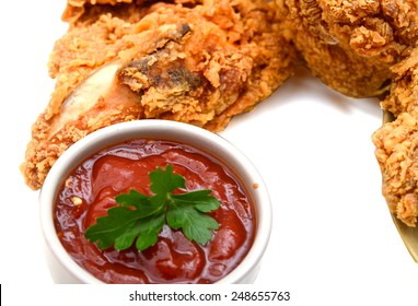 fried chicken with sauce on white background