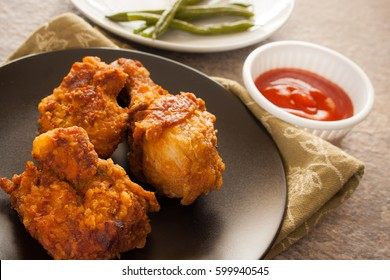 Fried Chicken served with home made tomato sauce and string beans