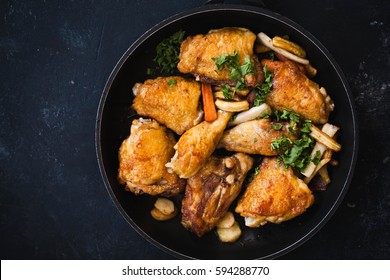 Fried chicken stew. Skillet Fried chicken with vegetable. Crispy fried chicken meat. Top view. slow-cooker chicken meat.