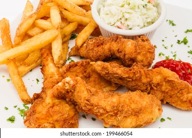 Fried chicken tenders served with french fries and cole slaw.