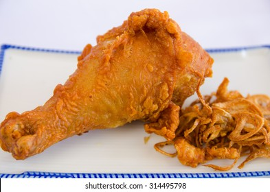 """Fried chicken as Thai style (Thai menu call name """"Hat Yai fried chicken"""" on white plate isolate white background."""