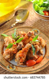 Fried chicken with tomato sauce