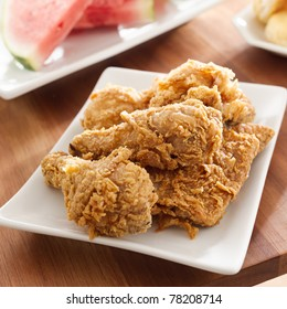 fried chicken and watermelon closeup