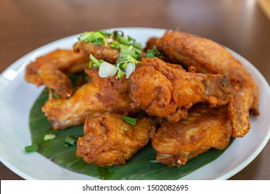 Fried Chicken Wings with Fish Sauce on White Plate.