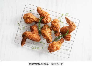 Fried chicken wings with fresh herbs