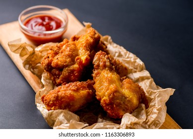 fried  chicken wings nuggets with ketchup