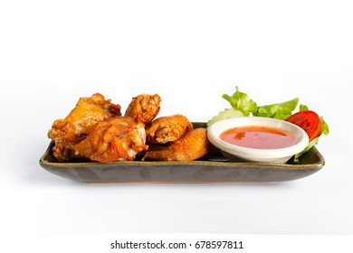 Fried chicken wings with sweet sauce on white background