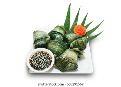 Fried Chicken Wrapped in Pandan with soy sauce and sesame isolated on white background (Popular restaurant-style dish in Thailand)