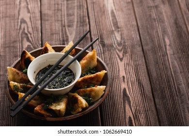 Fried Chinese dumpling called Gyoza, kind of asian food.