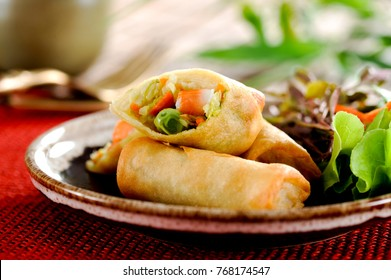 Fried chinese spring rolls with sweet chili sauce.