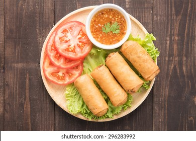Fried Chinese traditional spring rolls on wooden background