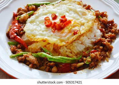 fried chop pork and yard long bean in sweet chili paste and egg