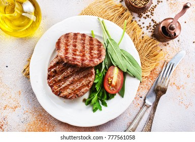 fried cutlets for burgers on white plate