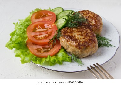 Fried cutlets  and vegetable.