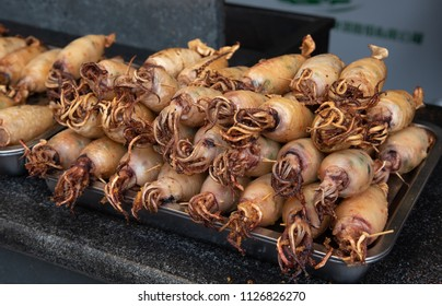 Fried delicious cuttlefish  seafood ready to be eaten on the snack street in Beijing China