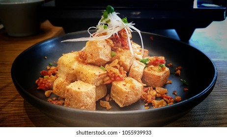 Fried diced crispy tofu with spicy salt and chili shoot by mobile camera.