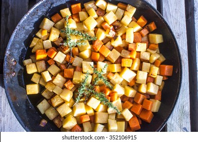 Fried dices of carrot and swede, in a pan + thyme