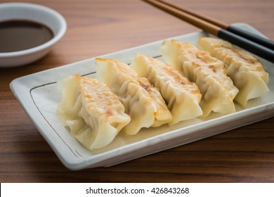 Fried dumplings on plate and soy sauce