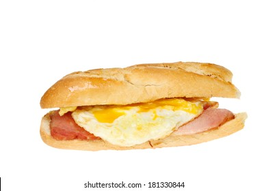 Fried egg and bacon baguette isolated against white