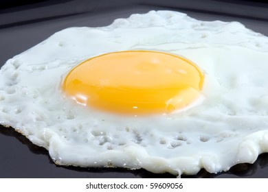 fried egg in black dish