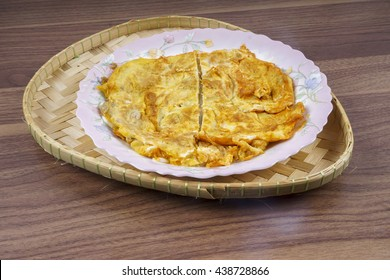 Fried egg for breakfast on plate and rustic table