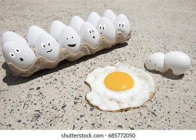 Fried egg with broken shells and carton of white eggs with illustrated faces on hot sidewalk on summer day.