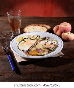 fried egg dish with zucchini and potatoes