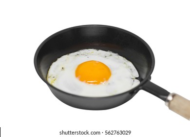 Fried egg in a frying pan isolated white background.