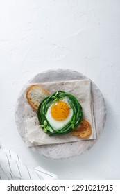 Fried egg with grean beans on toasted bread, copy space