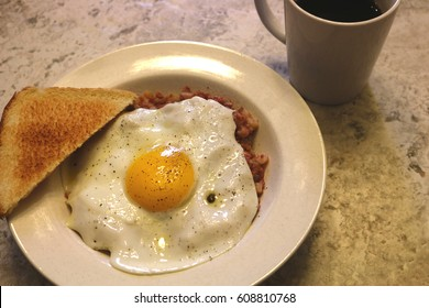 fried egg and hash breakfast with coffee