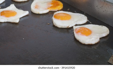 Fried egg on heart shaped and star shaped