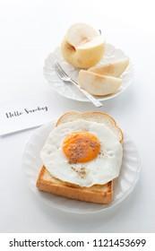 "fried egg on toast, fruit and text ""Hello Sunday"""