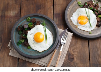 Fried Egg on Wholegrain Toast croutons, top view, copy space