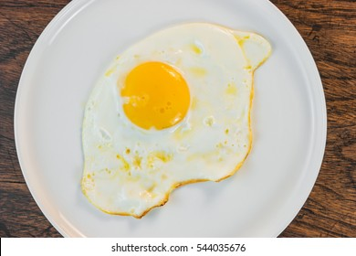 fried egg on wood table