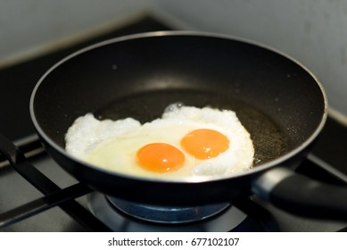 fried egg is the quick and easy menu to cook for breakfast food by fry on pan with spade