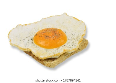 fried egg with salt and pepper on toast, closeup, isolated on white background