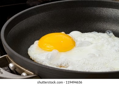fried egg sunny side up in a pan